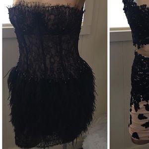 Dresses & Skirts - Feathered bottom mini dress